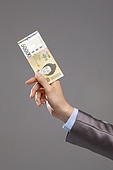 Business person holding Korean currency