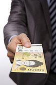 Business person offering Korean currency