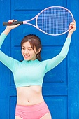 Young woman holding a tennis racket