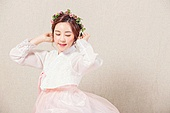 A beautiful Korean woman wearing a hanbok
