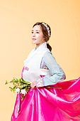 beautiful Korean woman in a hanbok with a bouquet of flowers