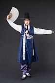 Korean man in a hanbok on a black background