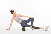 Korean woman doing stretching exercises using Foam Roller