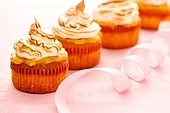 Cupcakes with whipped cream and icing