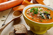 Homemade Thanksgiving Rustic Pumpkin Soup puree in ceramic Bowl