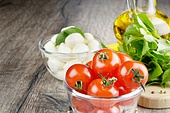 Mozzarella cheese, cherry tomatoes, basil leaves and olive oil - caprese salad ingredients