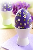 Hand crafted easter eggs on the wooden table