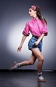 Woman in denim blue shorts posing in studio - fashion style
