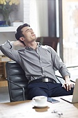 Tired young man relaxing in office
