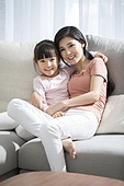 Happy young Chinese mother and daughter