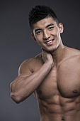 Portrait of young Chinese muscular man