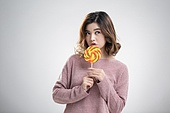 Young Chinese woman holding a lollipop