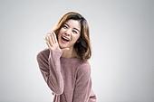 Cute young Chinese woman shouting