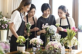 Young Chinese women learning flower arrangement