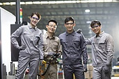 Confident Chinese engineering team in the factory