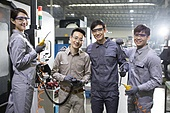 Confident Chinese engineers in the factory