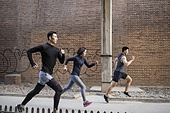 Young Chinese friends jogging outdoors