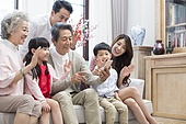 Happy family having video chat on smart phone during Chinese New Year