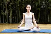 Young women practice yoga
