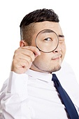 Business man with a magnifying glass