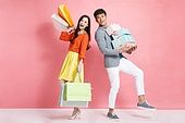 Fashion young couple holding shopping bags