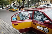 Young women go to work by taxi