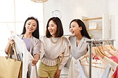 Young women's clothing store shopping in bestie