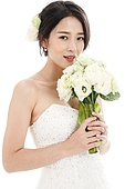 Beautiful bride holding a rose