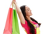 Young girls hold high the shopping bag