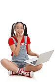 Young girls use laptops