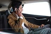 The business man on the phone in the car