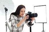 The young female professional photographer