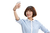 Youthful vitality of the young woman with a mobile phone