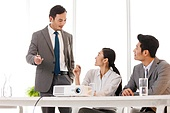 Business men and women to work in the meeting room