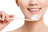 The young woman to brush your teeth