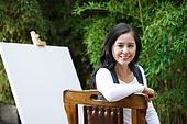 Elegant female painter in the yard