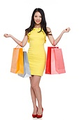 A young woman with a shopping bag