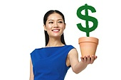 Business young woman holding a flower pot