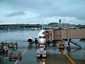 Airplane passenger jet loading at airport.