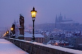 view on Charles bridge and Prague castle before dawn