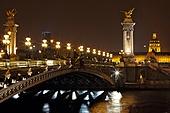 The Alexander III Bridge across river Seine at night in Paris, France