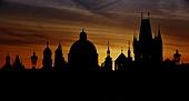 Prague silhouettes from Charles Bridge before dawn, Prague, Czech Republic