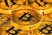 close up of bitcoins. close up of pile of golden bitcoins in backlight