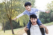Cheerful young family playing outdoors
