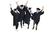 Happy college graduates in graduation gowns waving