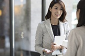 Confident businesswoman talking with a mature woman