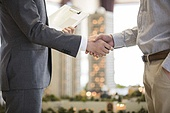 Young man shaking hands with realtor