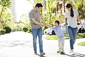 Happy young family playing with skateboard