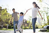 Happy young family playing outdoors
