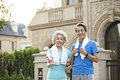 Senior couple with towel and water after jogging